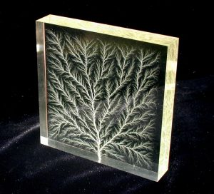 Lichtenberg figure in block of Plexiglas Acrylic